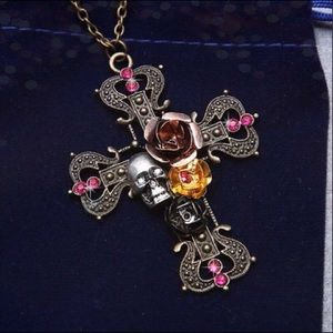 Skelton ornate silver finish cross with gem accent